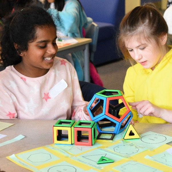 Two girls playing with Magnetic Polydron